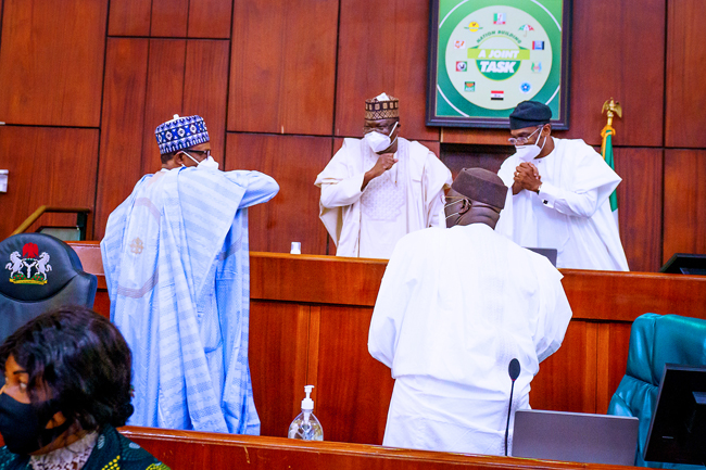 Buhari exchanging greetings with Leaders of the NASS